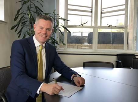 Derek Mackay signing the Scottish National Investment Bank Bill