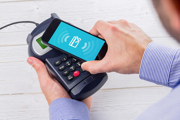Wifi connection against man using smartphone to express pay